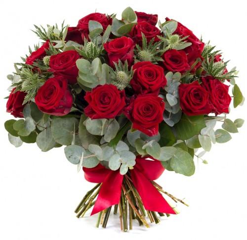 25 красных роз и экзотическая флористическая зелень